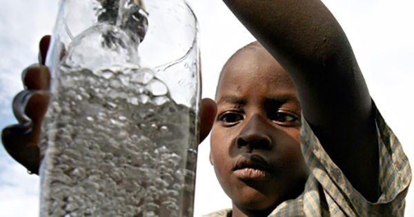 Low-income boy drinking water
