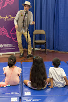 Storyteller captivating children in audience