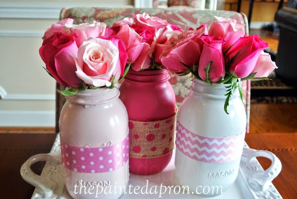 Jars painted and filled with roses.