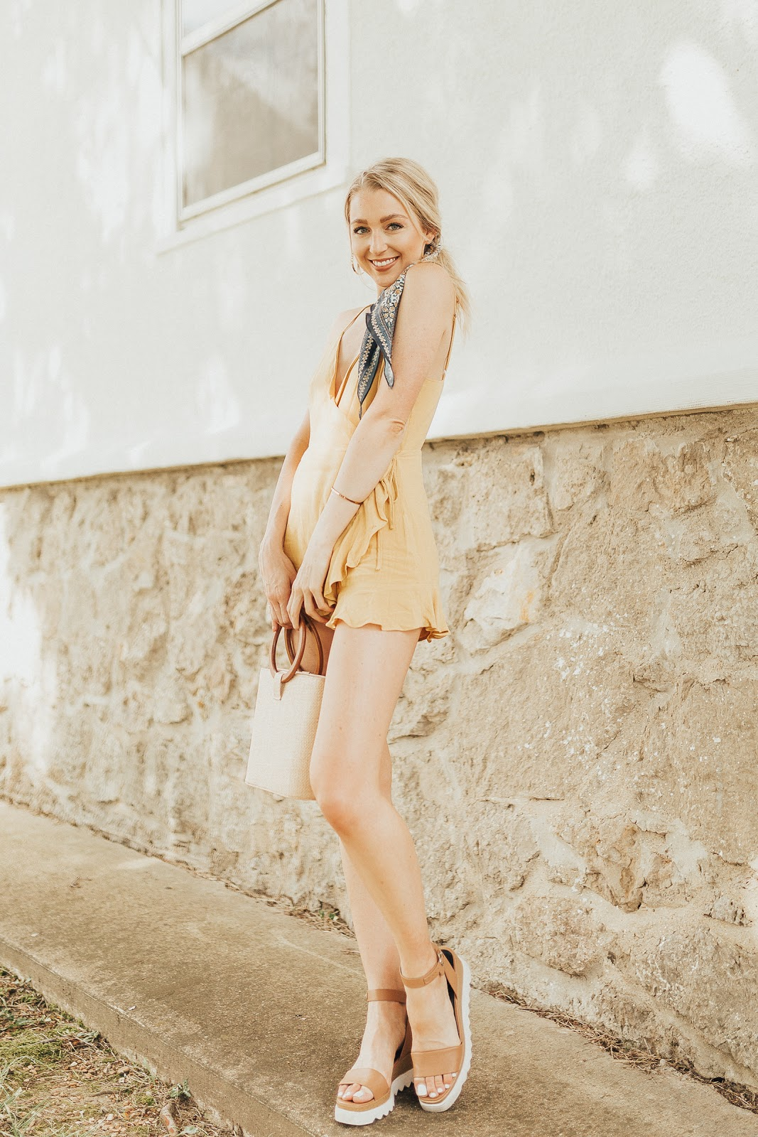 yellow romper with ruffle details