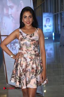 Actress Madhu Shalini Stills in Floral Short Dress at RGV Shiva to Vangaveeti Event  0143.JPG