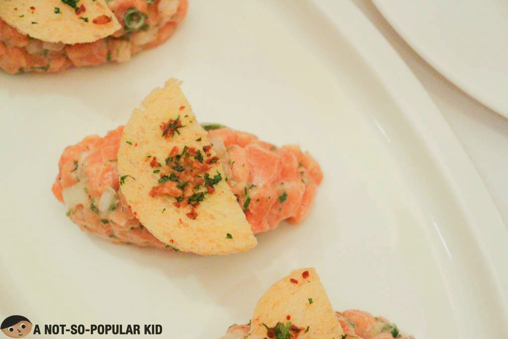 Freshly made and prepared Salmon Tartar of Cru Steakhouse
