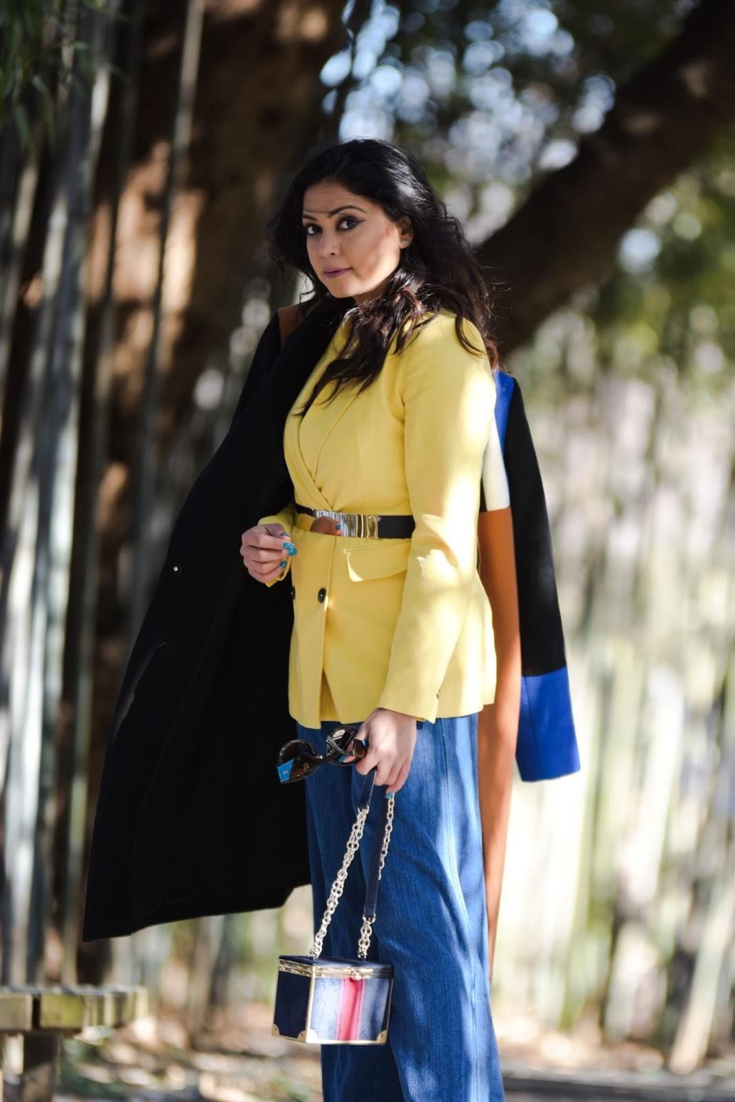 LAYERING 101- essentials you need to bundle up in style, winter layering, winter outfit, wide leg jeans, yellow double breatsed blazer, metallic stretch belt, pinty toe sock boots, colorblock coat, myriad musings , saumya shiohare 6
