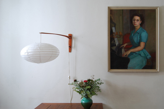 an oil portrait in dining room