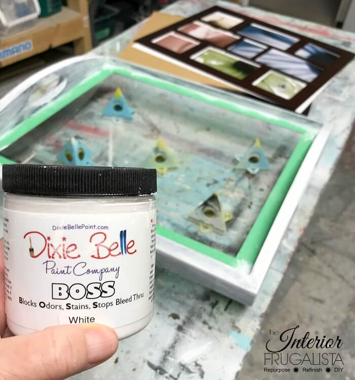 A budget-friendly upcycled thrift store tray with glass that can be changed for every season simply by switching out what's displayed under the glass.