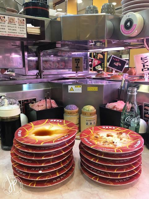 Pile of sushi plates - Genroku Sushi Sennichimae