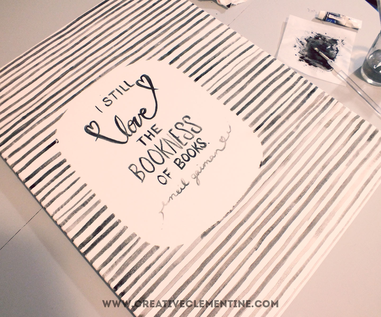 Easy hand painted DIY stripey quote art via creativeclementine.com. Step 4: Remove the contact paper. Touch up as needed.  Otherwise, it's done.