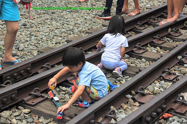 children playing on Rail lines, Tanjong Pagar Raiway Station, Singapore