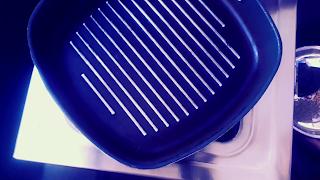image of tawa pan on flame