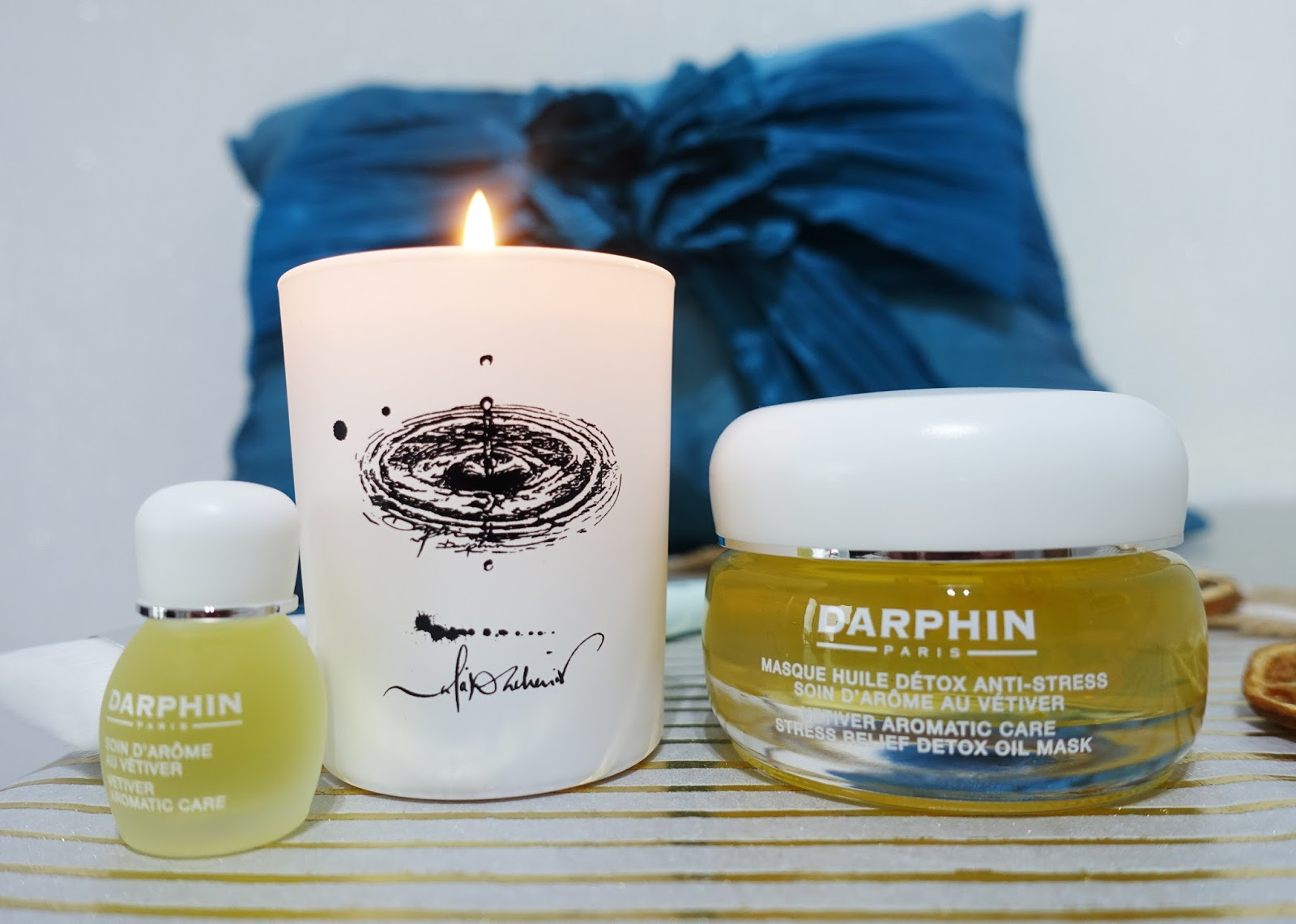 Image showing Darphin's Relax and Glow set: a vetiver facial mask, candle and oil to help reduce toxins and relieve stress.