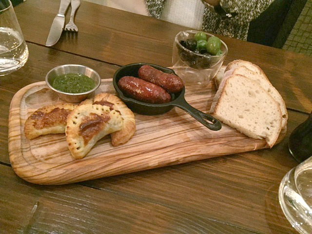 starter of bread, olives, pasties and sausages