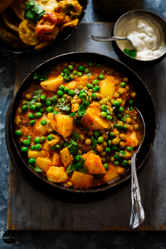 Aloo Matar is a typical Indian curry recipe that is made with potatoes and green peas.