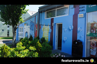 CORRIB VILLAGE 4 NUIG MURALS HAND PAINTED BY FEATURE WALLS PROFESSIONAL IRISH MURAL ARTISTS