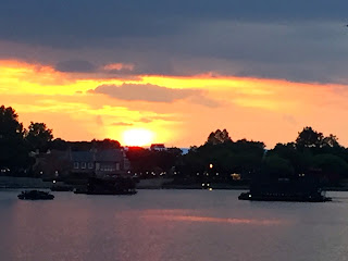 The sunsetting and shining on the lagoon at Epcot.