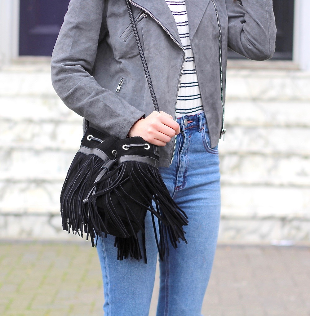 black fringe bucket bag