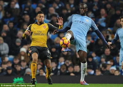 Yaya Toure says he is open to signing a new contract with Manchester City