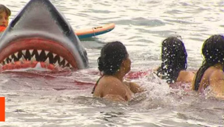 Watch As This Insane Shark Prank Scares Unsuspecting Beach-Goers Half To Death