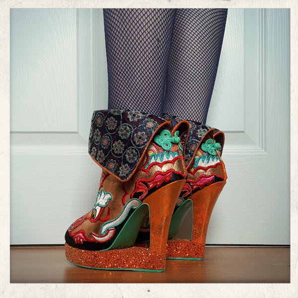 wearing irregular choice tatsu cut out heel boots