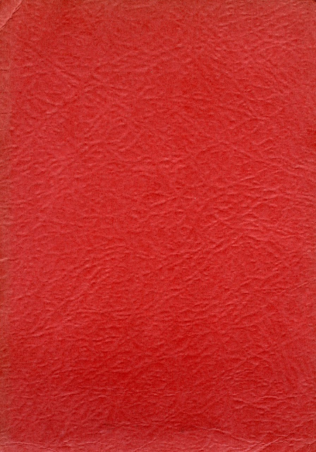A red carboard background from an old photo grame with impressed wrinkled.