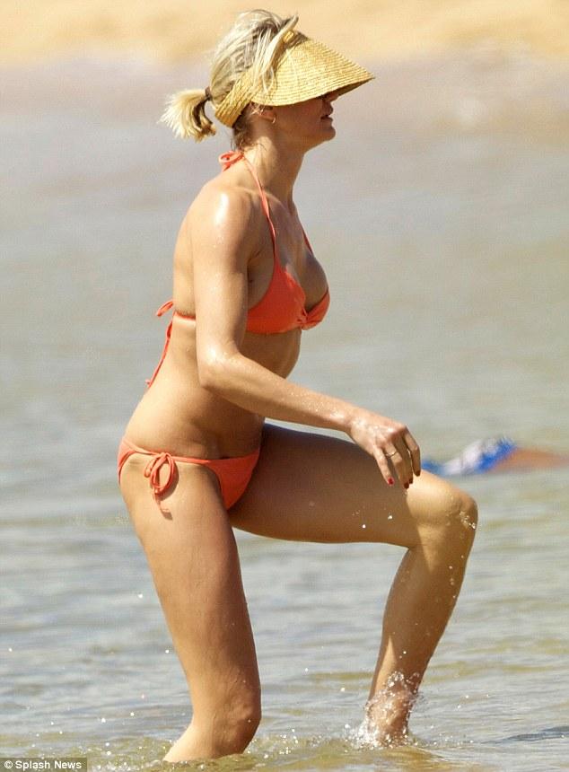 Cameron Diaz shows off a toned body in an orange bikini Cameron Diaz Pregnant August 2018
