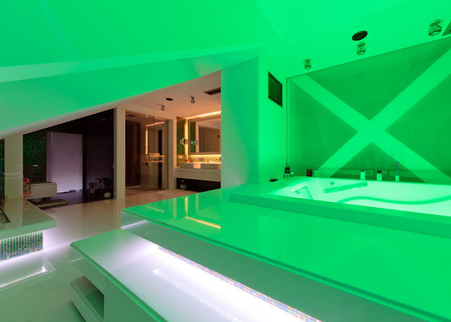 Picture of the modern bathroom with green lighting