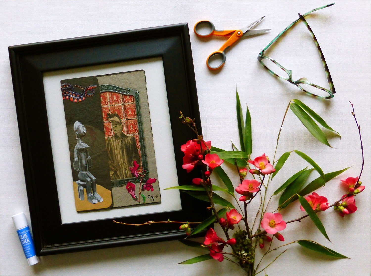 Two Women No. 2, collage, African sculpture, vintage newspaper cut out, antique postage stamps, antique photo frame, book cut images, black and red snake, red flowers, snap dragons