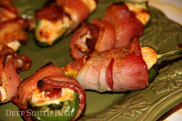 A delicious party appetizer, these bacon wrapped, smoked sausage and cheese stuffed jalapenos are a true crowd pleaser.