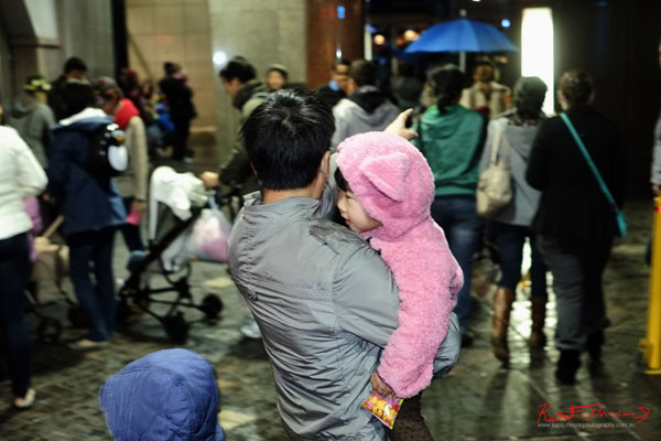 Father with child in a 'Pink Bunny Onesie',  Vivid light Show Sydney 2013 - Fujifilm X-Pro1, XF35mmF1.4 R.