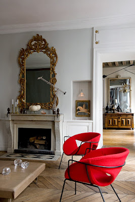 Parisian apartment, fireplace and red chairs