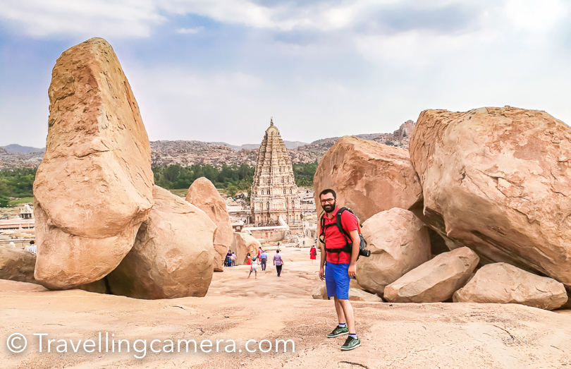 I got to know about Hampi in 2007 when I had started learning photography and I used to bug a lot of my mentors to click some creative shots with DSLR cameras/lenses. That was the time when I used to spend a lot of weekend time with Camera & traveling. Some of my Bengaluru friends had visited Hampi & shared their photographs. Heritage sites and  Architecture used to be the favorite sites of Travellingcamera and they still are. This year I got a chance to get a glimpse of Hampi and it's ruins. I would still say it glimpse as Hampi is a lot of offer and you can spend good amount of time around these ruins to learn about history and architecture at the same time. I strongly believe that it's certainly a must visit place for Photographers & Explorers. There is so much diversified subjects to explore. Without any delay let me come to the main Agenda of this post and let's talk about ways to reach Hampi.    Hampi Travel Guide : How to reach, Where to Stay & Things to do !   Virupaksha Temple in Hampi, Karnataka (South India)