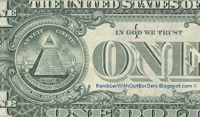 "US Dollar bill with the words ""in gold we trust"""