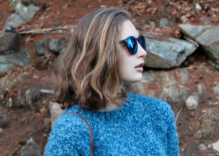 Blue handmade knit sweater, LA Hearts blue reflective sunglasses, bootcut dark washed jeans and leather slip on sneakers