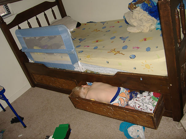 15+ Hilarious Pics That Prove Kids Can Sleep Anywhere - Napping In A Drawer Under The Bed