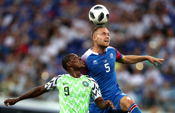 Odion Ighalo of Nigeria and Sverrir Ingason of Iceland compete for a header during the Russia 2018 world cup