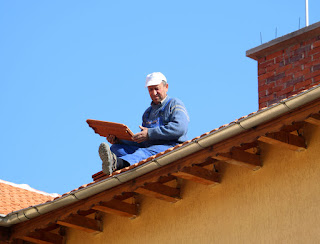 Bekir working on the roof