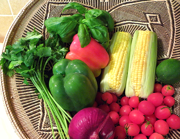 Corn, Red and Green Bell Pepper, Cherry Tomatoes, Red Onion, Parsley, Basil and Lime in Basket