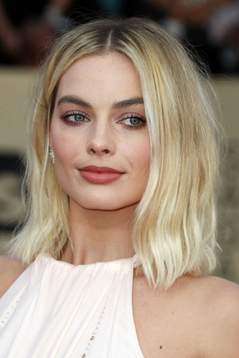 Margot Robbie's face is beautifully framed by the lightest shade of blonde, drawing attention to her eyes. To keep cool blonde highlights from going brassy, try a purple shampoo like Redken Blonde Idol Shampoo