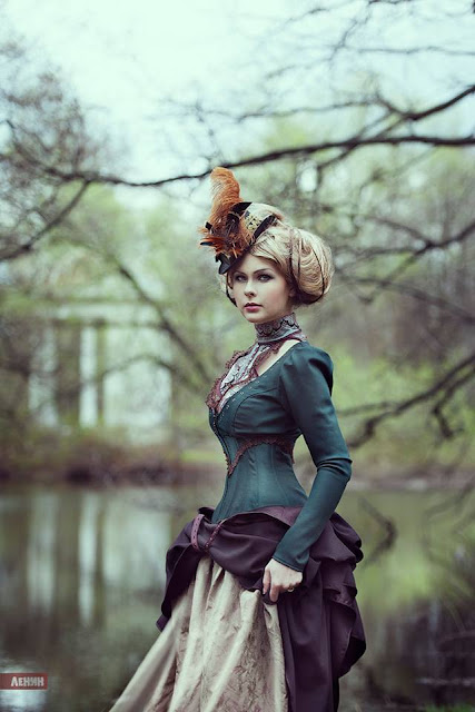 Victorian clothing for women. This girl is wearing a Victorian costume consisting of a hat, bodice and skirt.