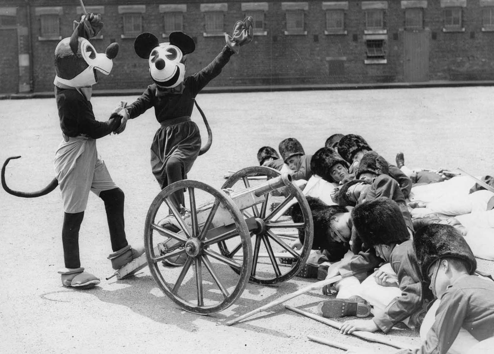 Mickey and Minnie Mouse at a dress rehearsal of the Woolwich Searchlight Tattoo, London. 1933.