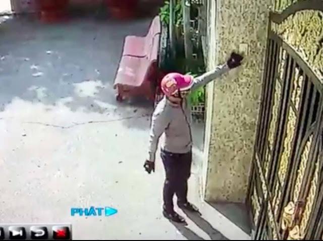 Camera ghi lại hình ảnh 1 thanh niên đến trước cổng bấm chuông rồi lập tức bỏ đi