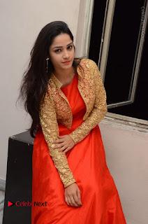 Telugu Actress Divya Nandini Stills in Orange Sleeveless Gown at Chennai Chaitrama Movie le Launch Event  0106.JPG