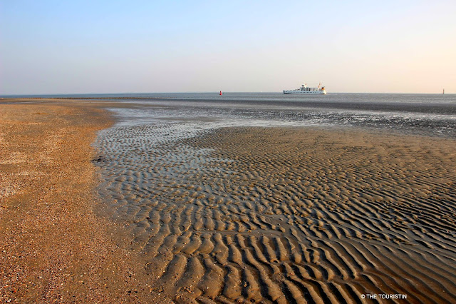 UNESCO heritage listed Wadden sea with a passenger ferry in the distance.
