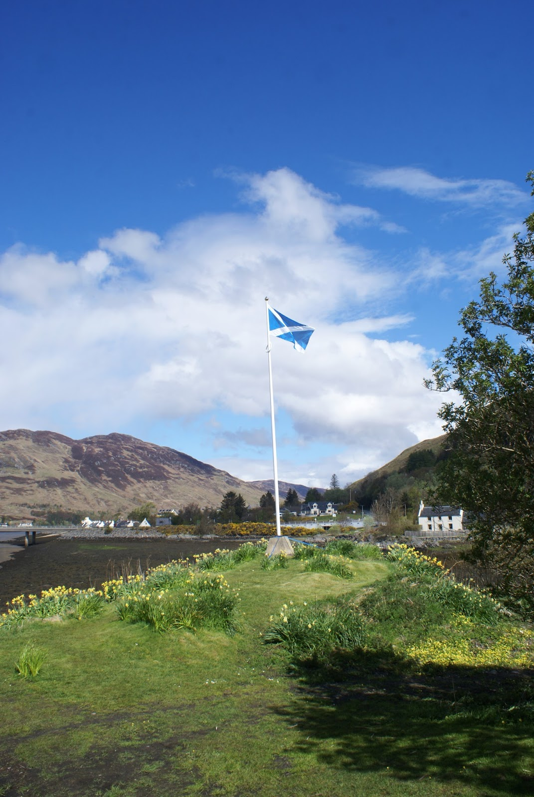 eilean donan castle dornie scotland flag uk road trip travel united kingdom