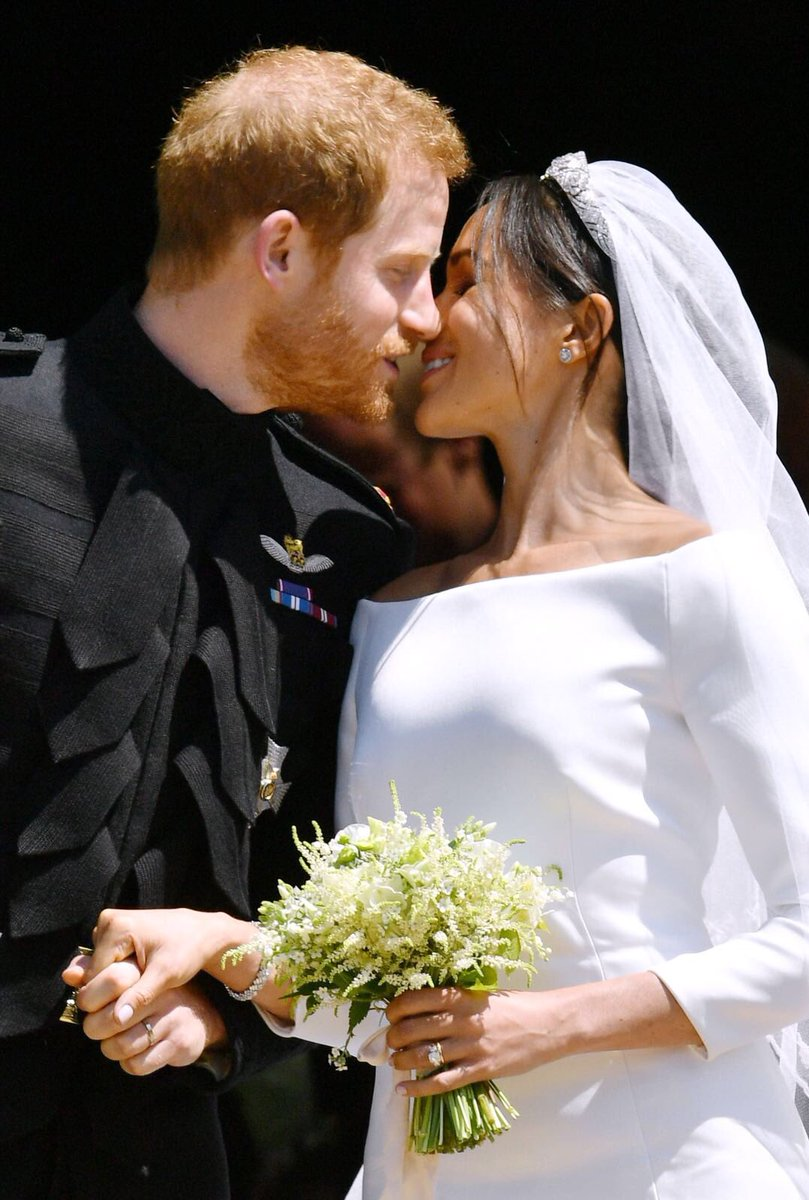 Meghan Markle and Harry's first kiss as crowds cheer Royal Wedding