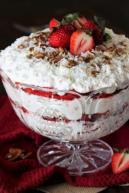 Classic Southern Punch Bowl Cake Image ~ Scrumptiously creamy layers of angel food cake, fresh strawberries, whipped cream, and coconut.