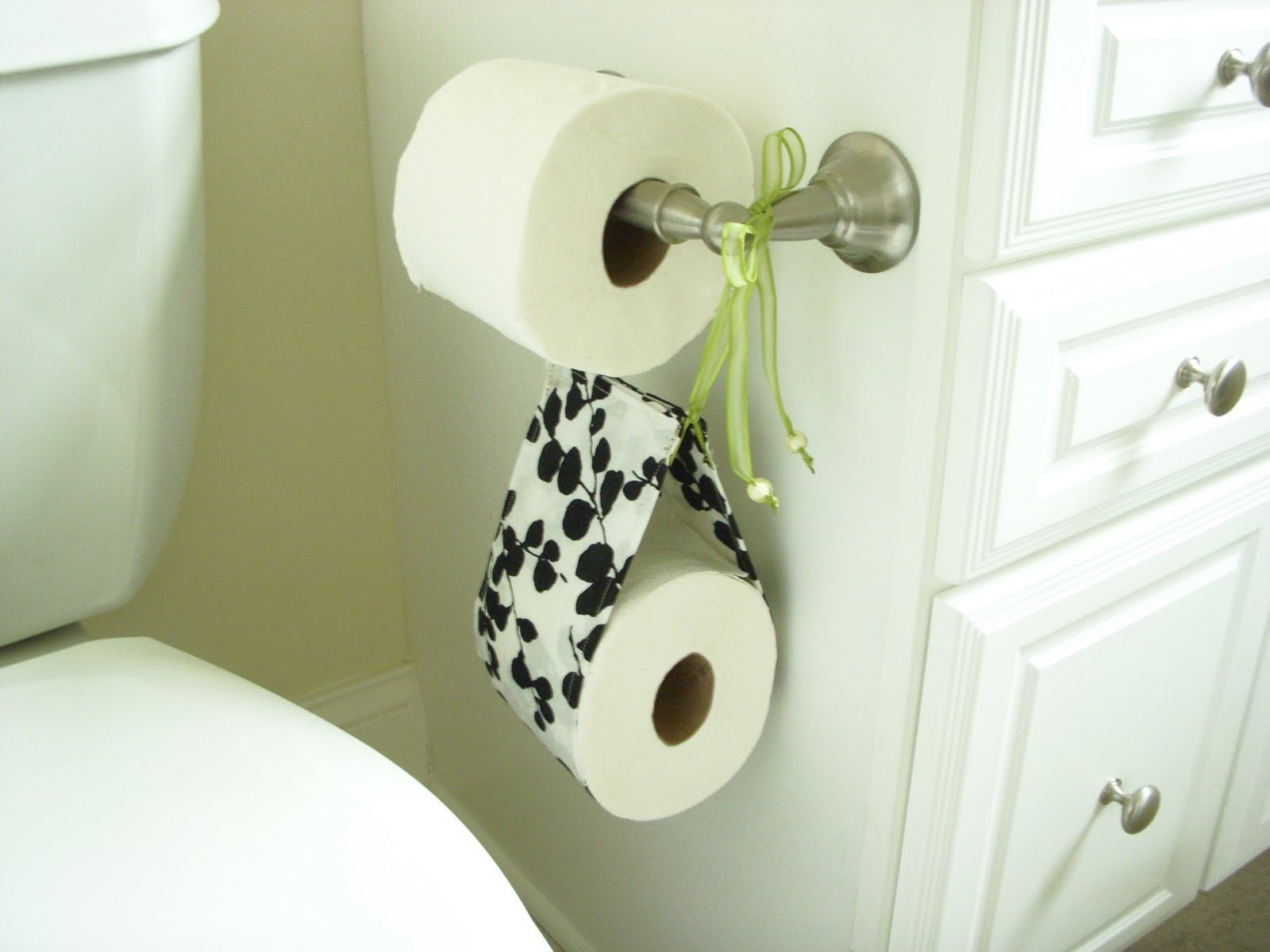Cool Toilet Paper Storage: Hope Studios: (Pretty) Spare Toilet Paper Holder