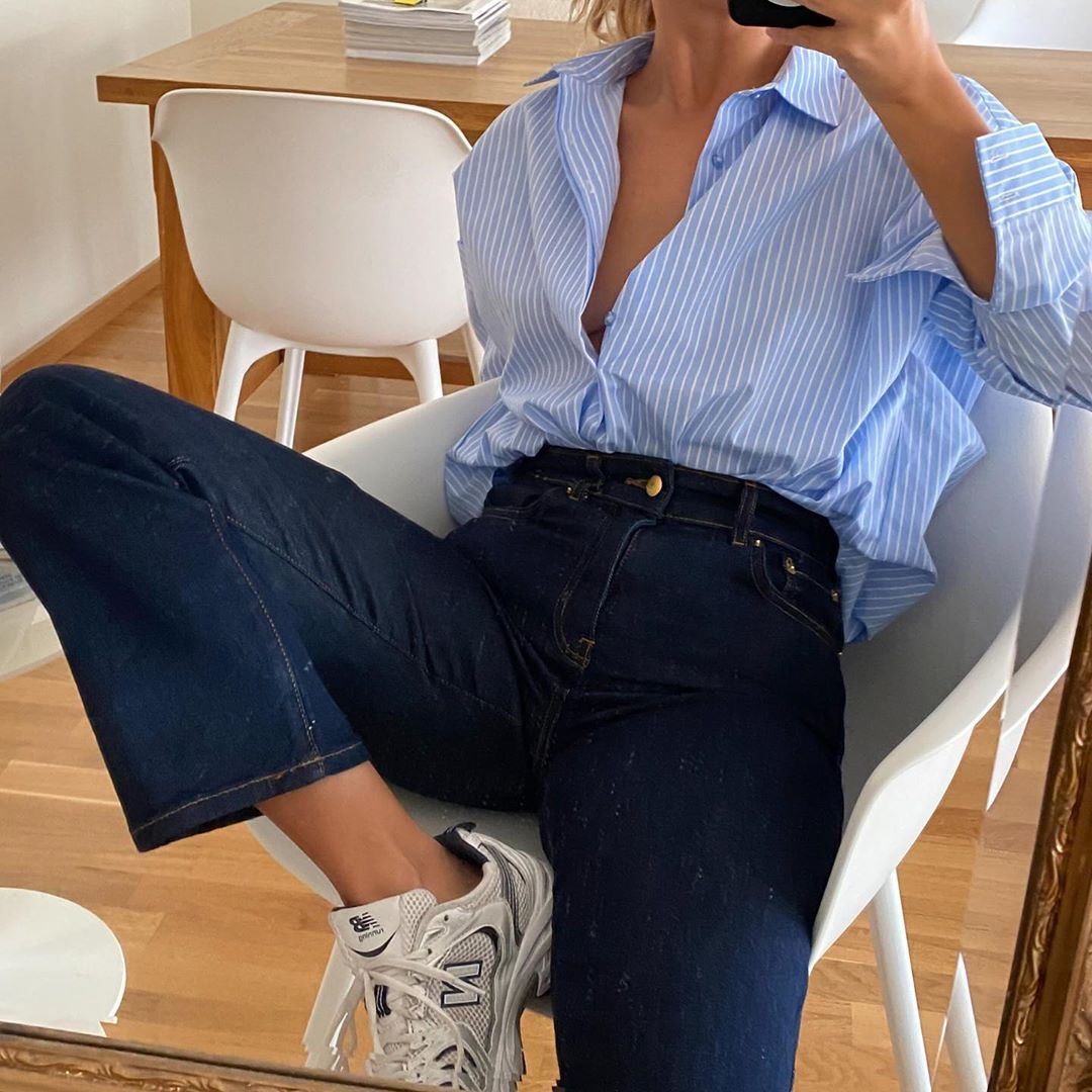 Instagram Summer Outfit Idea for Quarantine — Matilda Djerf in a Striped Blue Button-Down Shirt, High-Waisted Jeans, and New Balance Sneakers