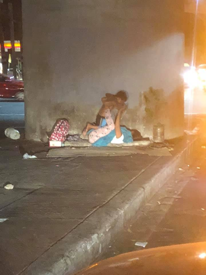 Touching Photo of Homeless Mom Playing with Her Son at Sidewalk