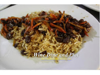 Qabili Pilau is an Afghan rice dish with raisins. The recipe is on Wine Dine And Play