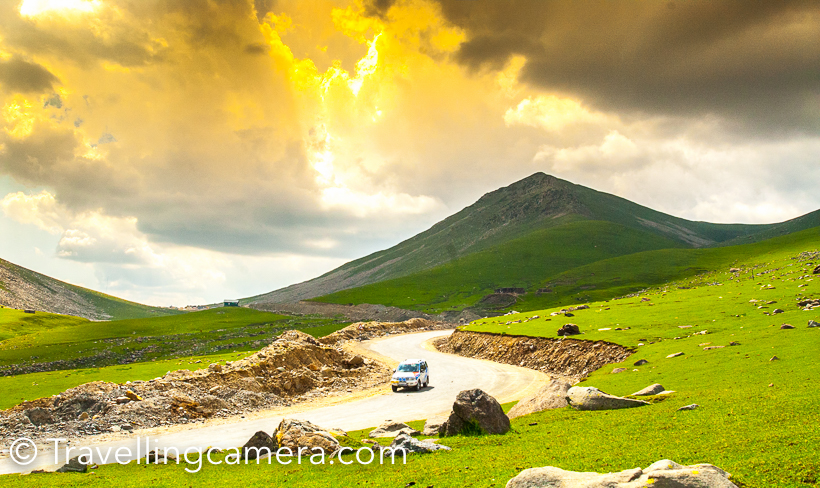 When in Kashmir, we drove to Daksum, Anantnag, Sinthan Top and Kishtwar from Srinagar. This road also connects Srinagar with Jammu, but we had taken Mughal road  to hit Kashmir Valley when drove from Delhi. These is one of the most beautiful terrains of Kashmir Valley. In fact, it would be unfair to compare various terrains in Kashmir Valley, because all of these have unique character and equally beautiful. This Photo Journey shares more about this route, it's terrains and some important facts.Daksum is surrounded by dense forests with Bringhi River flowing right through its center. Daksum has been a popular destination for explorers and adventure lovers. Green meadows around Daksum look amazing and if you are lucky, you can find few shepherds singing some local songs. We met a gentleman, who loves playing flute. Unfortunately we didn't want to get clicked, so I don't have his photograph. All this may sound filmy but that's what you experience in Kashmir Valley.Clouds of Kashmir Valley are very interesting and naughty. They keep playing games with you, especially hide-n-seek.I clicked hundreds of cloud photographs in Kashmir. If you are lucky, these clouds also try to surround you from closer distance. Especially in early morning and late evening. Most of the times, these hills get drizzle.  On these terrains around Sinthan Top, you feel like stopping your car and sit around the edge to experience the cool breeze blowing through the valley and green landscapes all around. It's a must do experience at a place where you find peace around these hills.Road connecting Srinagar with Sinthan Pass goes through beautiful landscapes full of green meadows, dense forests, cities, some beautiful mosques and paddy fields.Above photographs is clicked during Mughal Rally (A motorsport event organized by Himalayan Motorsports). The Sinthan pass connects Kashmir valley with Jammu Province through Kistwar. Pass is 12500 feet above sea level and is snow-capped for most of the year. It is located at the Anantnag-Kokernag-Kishtwar NH1B Highway and is 130 km south of Srinagar and 72 kilometers from Anantnag and approximately 50 kilometers from Kokernag.These curvy hills offer you unmatchable views of snow capped hills shimmering with sunlight and intense shadows of clouds. Flora and fauna of Kashmir valley welcomes you with open arms on the way to Sinthan top. There are very few tourists come to this part of Kashmir valley. Some of the most popular destinations in Kashmir are Srinagar, Pehalgaon, Gulmarg and Leh.Sinthan Top has no local population. Shepherds from adjoining places like Kokernag, Duksum, and tourists and those working in the tourism industry may stay overnight in tents. There is a small tea shop at top, which serves tea and basic snacks to tourists and army folks roaming around.This post is sharing only the landscapes of green meadows and some of the hills full of snow. But the drive from Srinagar to Sinthan Pass offers you lot more than that. Foothills of Sinthan Pass on both sides have very beautiful villages full of wooden houses, which are usually seen in movies. All of those seemed old and most of the newer houses near road were all modern with concrete construction.  From Sinthan pass, there is an uphill trek to Sinthan top. The uphill climb to Sinthan top is a difficult and steep. Initially we hesitated to take this challenge but when did it, we found it worth. That was one of the best moments from our kashmir valley.How to reach this part of Kashmir Valley -Srinagar has nearest airport.  Anantnag railway station is also connected with Kashmir Railway that runs from Baramulla to Qazigund. If you are in Jammu or Srinagar, you can hire a taxi or take bus for this part of Kashmir Valley.Lodging around Sinthan Pass, Anantnag -There are not many places to stay in Daksum. A few decent options can be found in Anantnag or Kokernag. Now some of the NGOs are actively running homestays in this part of Kashmir. One can find some goods option to stay in Anantnag. There are enough dhabas and restaurants serving local and Indian cuisine. It's recommended to do more research about the place and do advance booking. Also keep a track of local news, before you head there.This part of Kashmir and Peer Panjal mountain ranges are like heaven on earth. These grand views hypnotize all travellers and tourists crossing through Sinthan Pass. Every turn offers you new surprise and journey remains interesting.You can find lot of snow around Sinthan Pass, but remains of snow can be seen at distant places as well. Above photograph share true colors and mood of Kashmir - the bright blue sky, pure white clouds and snow covered green meadows.Two companions of Travellingcamera who were accompanying me in Kashmir exploration.
